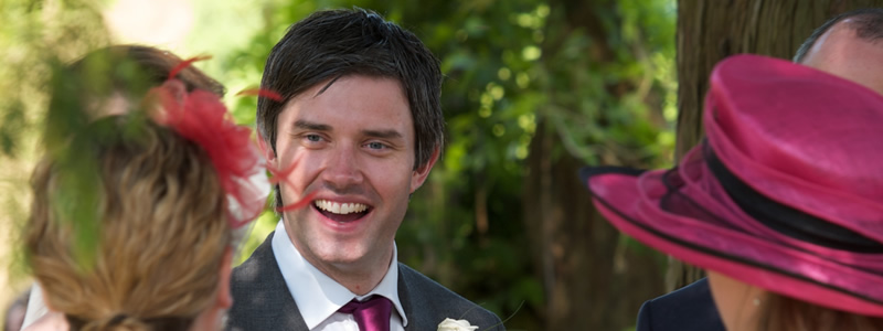 Groom smiling at Cotswold wedding reception