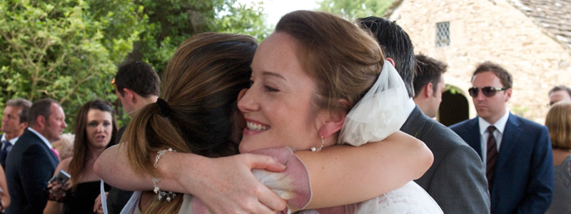 Hugs for the bride at Wiltshire wedding reception