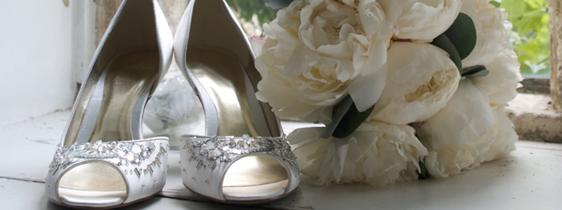 Wedding shoes and flowers at Wiltshire wedding venue